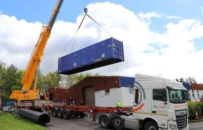 Scotmas water purification loads container onto lorry