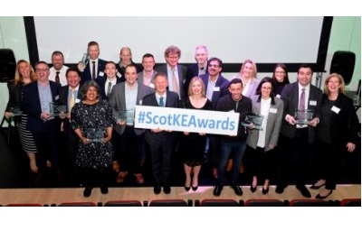 Group of people holding awards and smiling