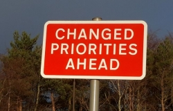 Road sign reading Changes Priorities Ahead